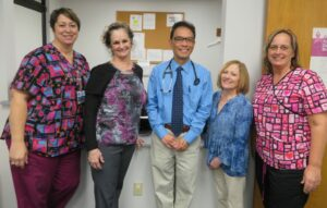 Members of the Pana Community Hospital Oncology staff with Dr. Benjamin Esparaz